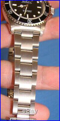 MINT ROLEX SUBMARINER BLACK DIAL withSTAINLESS BAND ALL PAPERS, BOXES & TAG